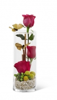 3 Roses in a tall thin vase.  Very fun design